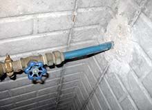 Photograph of polybutylene water supply line entering through foundation